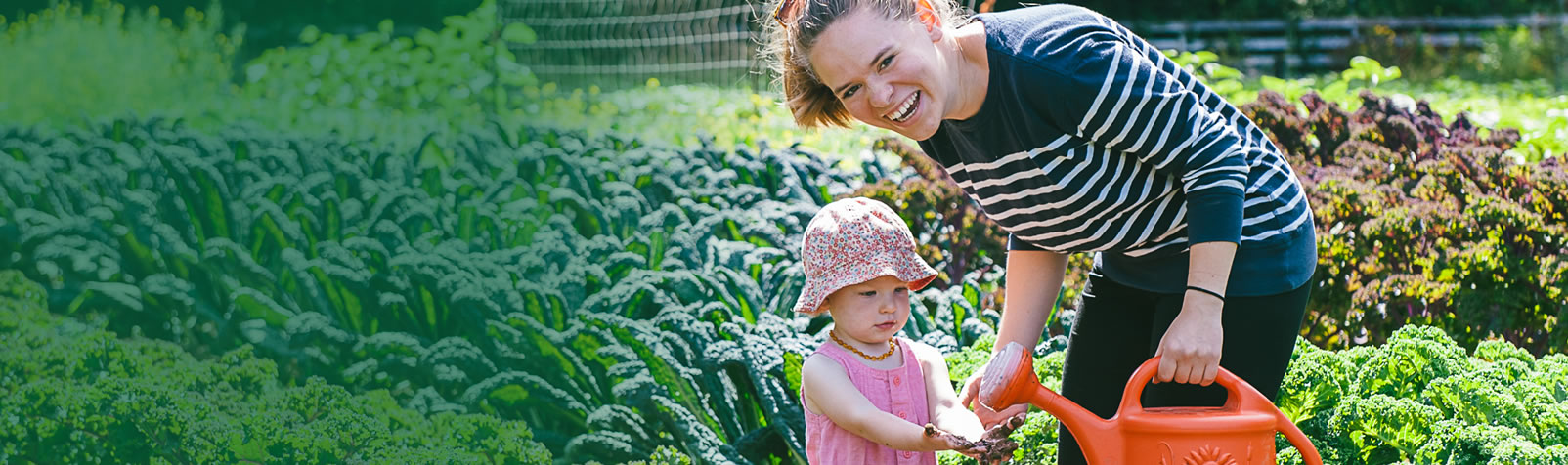[Inspiring Hope, Caring for Creation] A Rocha intern gardening with a young child