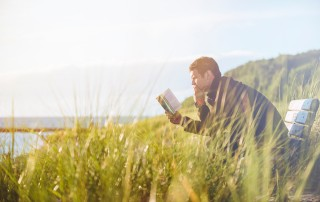 Man sitting and reading book