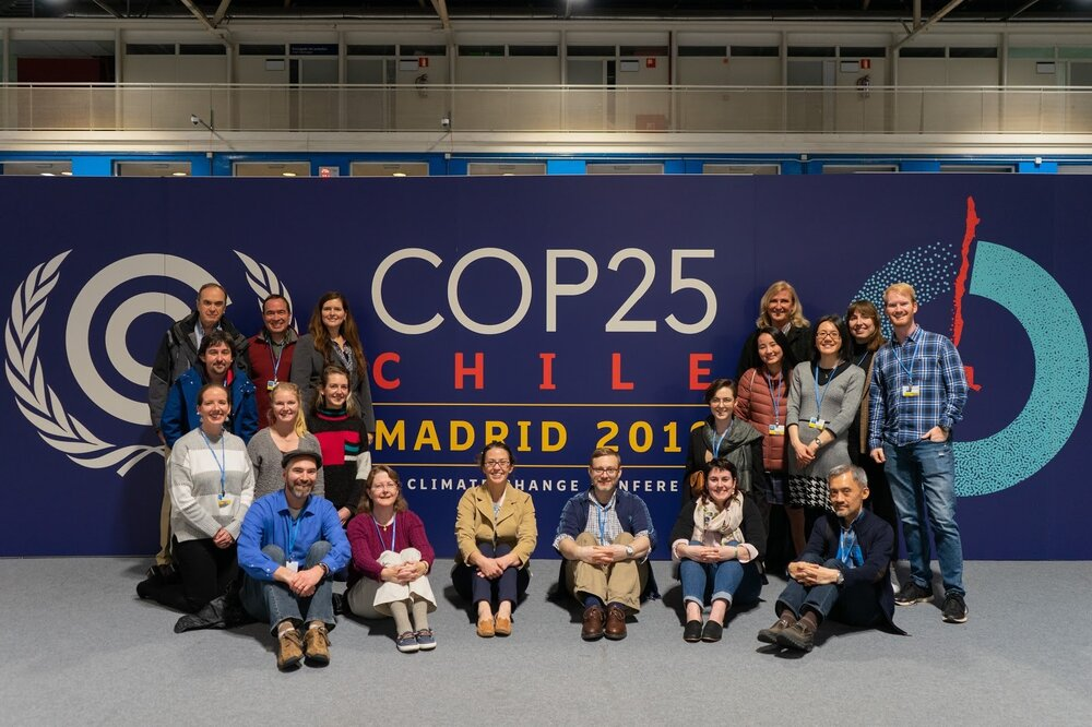 team group photo in front of COP25 sign