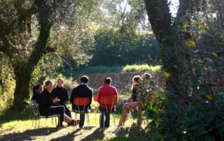 People sitting in a group outside