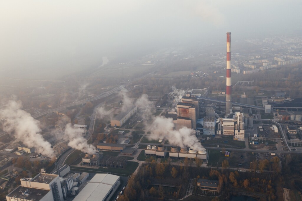 Aerial view of factories and their smoke emissions